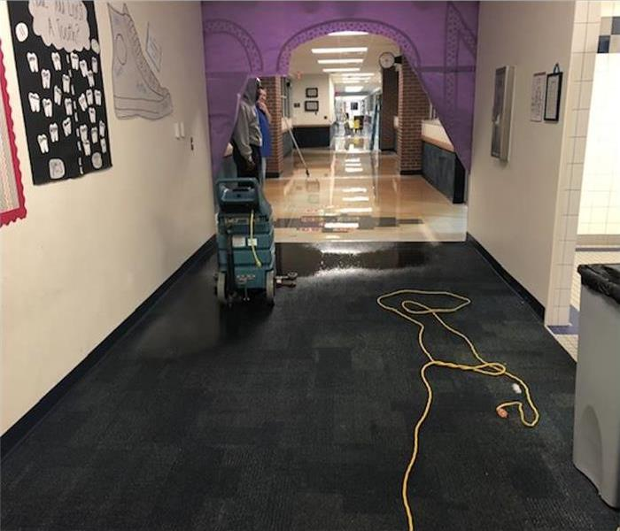A woman walking in an office full of water