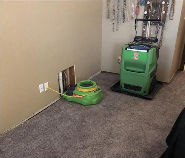 Air mover and dehumidifier in a home